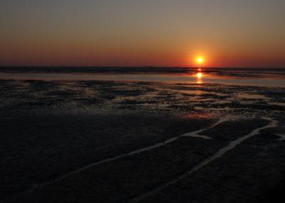 Sonnenuntergang über dem Wattenmeer